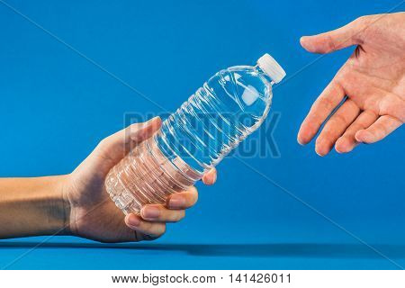 plastic bottle water on blue color background