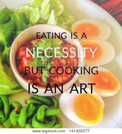 Inspirational quote on blurred background...eating is a necessity but cooking is an art