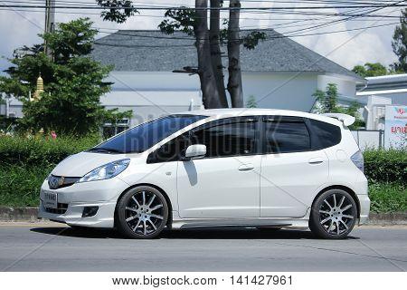CHIANGMAI THAILAND -JULY 27 2016: Private car Honda Jazz Hybrid. On road no.1001 8 km from Chiangmai Business Area.