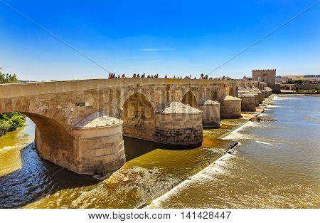 Ancient Roman Bridge Entrance River Guadalquivir Cordoba Spain Roman bridge was built in the 1st Century BC.