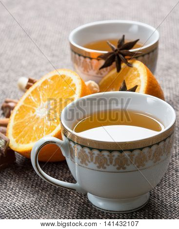 hot green tea composition with big oranges