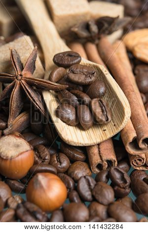 wooden spoon with coffee beans and nuts