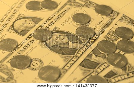 One cent coins and One Dollar banknotes currency of the United States useful as a background - vintage sepia look