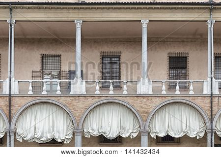 Windows external view pink wall white drapes