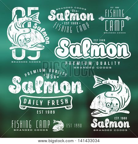 Set of fishing labels in retro style. White print on blurred background