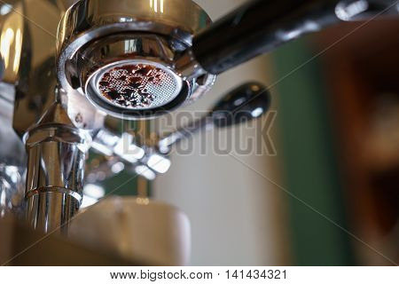 espresso pouring from bottomless portafilter, low angle shot