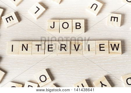 Job Interview word written on wood block. Wooden Abc.