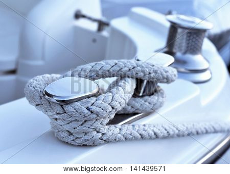 Moored motor yacht, close-up shot. Rope of a yacht.