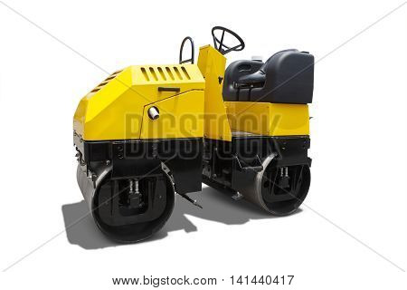 Image of a new asphalt compactor machine with yellow color in the studio isolated on white background