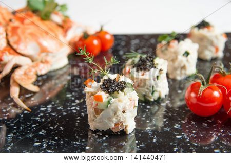 Crab Meat Salad with Black Caviar Horizontal tomato and crabs