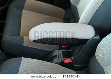 armrest in the car, detail in the interior of the car
