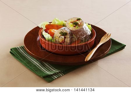 Wild Mexican burritos on wooden bowl on grey background