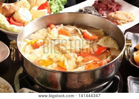 Vegetable hot pot with corn cabbage tomato beef and pork in chinese stew