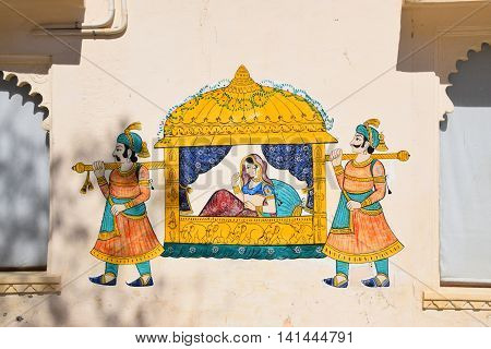 Traditional indian wall paintings on the walls of City palace in Udaipur, Rajasthan, India