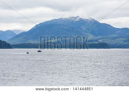A commercial fishing boat in the Alaskan wilderness