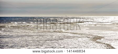 Seascape with late afternoon light at the beach