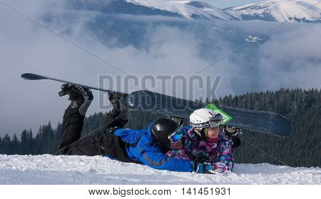 BUKOVEL UKRAINE - 14 FEBRUARY 2013: Couple of snowborders poses during the annual winter school holiday