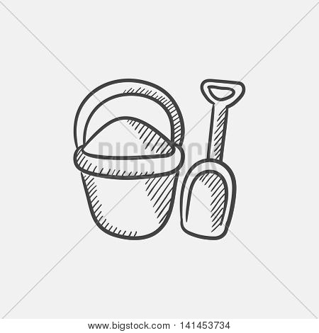 Bucket and spade for children sketch icon for web, mobile and infographics. Hand drawn vector isolated icon.