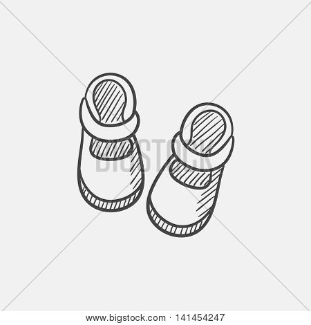 Baby booties sketch icon for web, mobile and infographics. Hand drawn vector isolated icon.