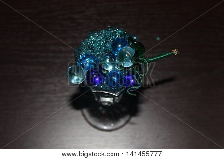 sprig of glass beads on the vase