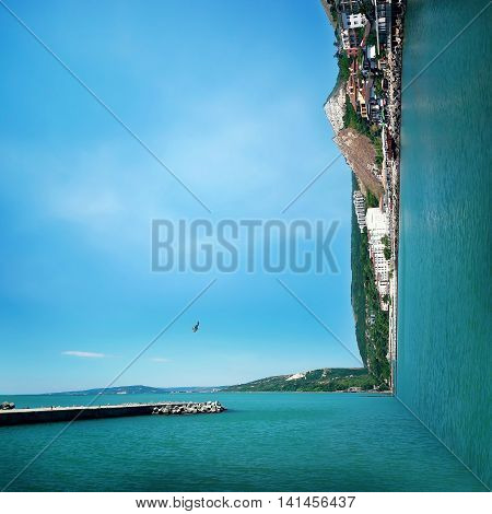 Surreal background of two worlds collide at the coast of the sea. Sea landscape journey and vacation concept.