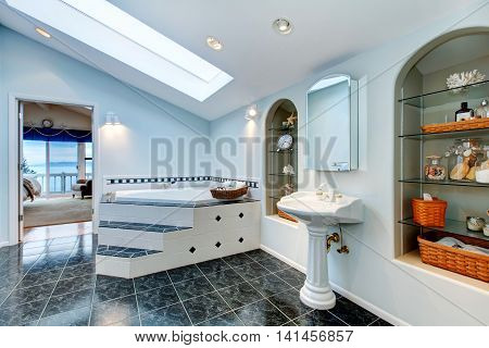 Master Bathroom With Blue Marble Tile Floor And Corner Bath Tub.