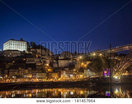 porto ribeira riverside old town and landmark bridge view in portugal at night