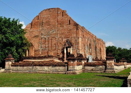 Ayutthaya Thailand - December 21 2010: View of the brick Ubosot sanctuary hall ruins at Wat Maheyong which dates to the 15th century