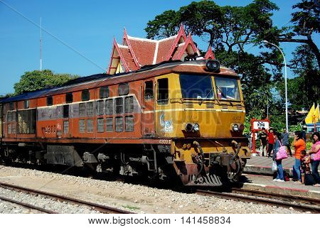 Hua Hin Thailand - December 31 2009: A Thai Railways train arriving on Track One with passengers waiting to board at the Hua Hin train station *