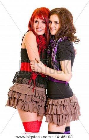 Two good girlfriends happily embracing isolated on white