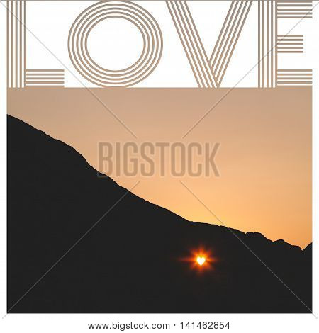 Sunet through the heartshaped hole in the cliff with love sign
