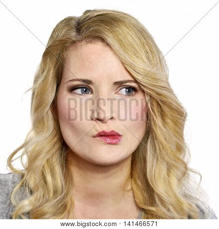 Pensive blond woman looking to the side. Young, toughtful or thinking looking woman,isolated on white.