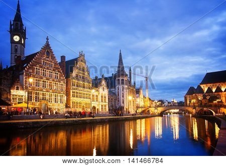 Exterior of illuminated buildings with canal, Ghent, Belgium, toned