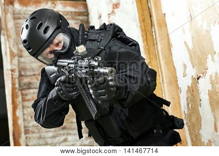 Special forces armed with assault rifle ready to attack