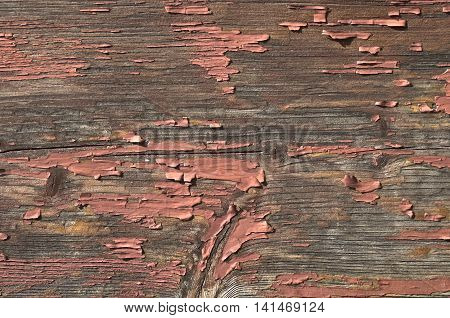 the surface of old wood with remnants of brown paint