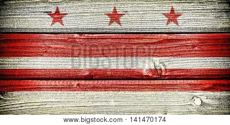 3d illustration flag of the District of Columbia painted on old grungy wooden background