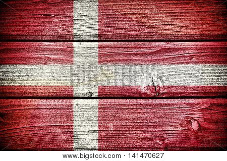 3d illustration Flag of Denmark painted on old grungy wooden background