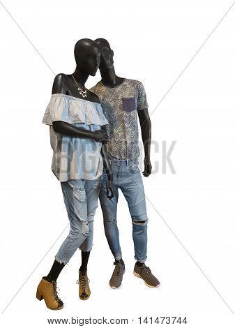 Two mannequins male and female dressed in casual summer clothes. Isolated on white background. No brand names or copyright objects.