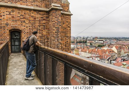 Man Admiring The City From The Top.