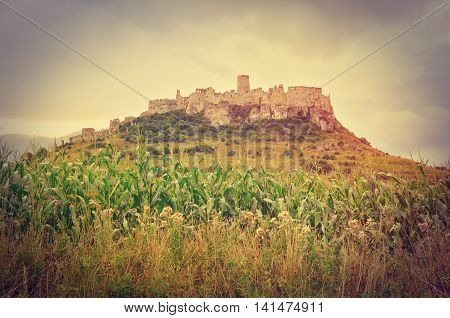 Beautiful ruins castle on the hill in vintage style. Spissky Hrad castle in Slovakia.