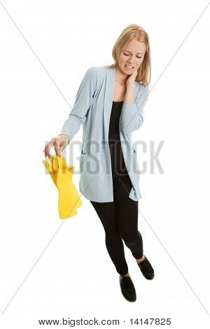 Frustrated woman in despair before cleaning