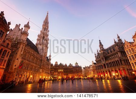 View of illuminated Grand Place and town square at night, Brusseles, Belgium, toned