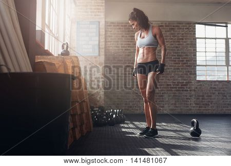Fit And Young Woman Standing In Crossfit Gym