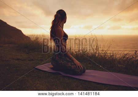 Fitness Woman In Vajrasana Pose At Sunset
