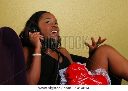 African American Woman Gossiping On The Phone
