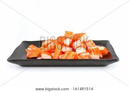 Imitation Crab Stick in a black plate isolated on white background