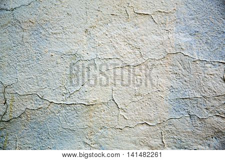 Damaged plasterwork on old wall. Background texture with space for text.