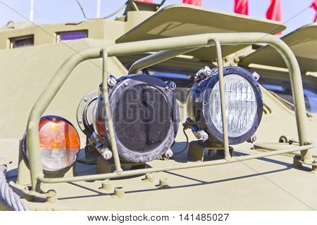 Headlight of military machine at the exhibition under open sky