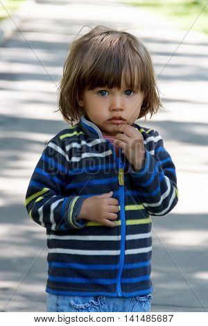 little young girl looking at camera outdoor
