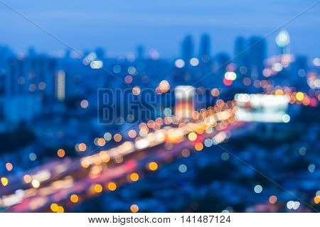 Blurred light night view, city road and highway during busy hours